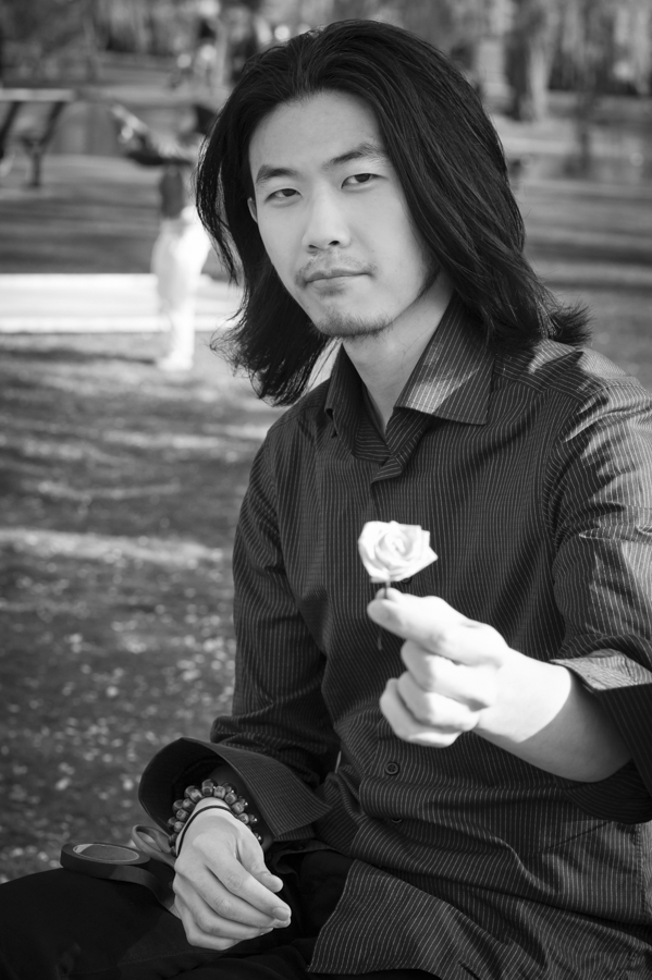 Young Kim at the Public Garden offering free handmade roses, taken April 28, 2013.