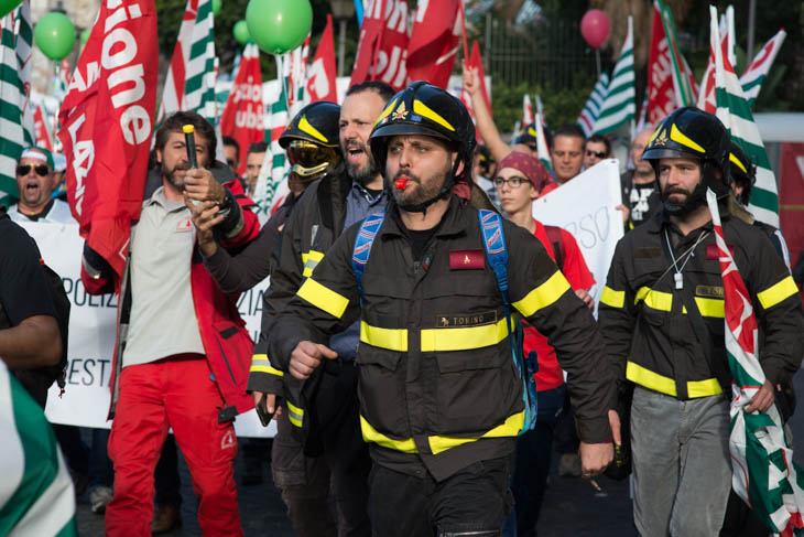 firefighters in a protest parade in Rome