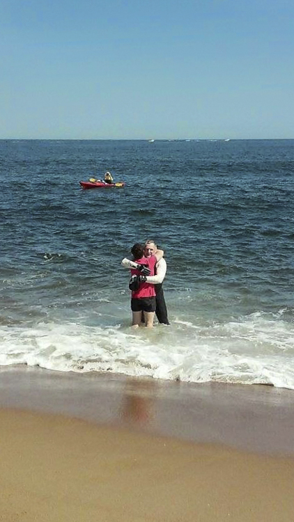 I remember...completing my 8 mile swim the length of Plum Island to raise money for Milo's surgery.   This was my Christmas!  Here I am with Milo, and that is Debbie Feinman in the kayak as my support crew.  Photo by Helen Hynes.