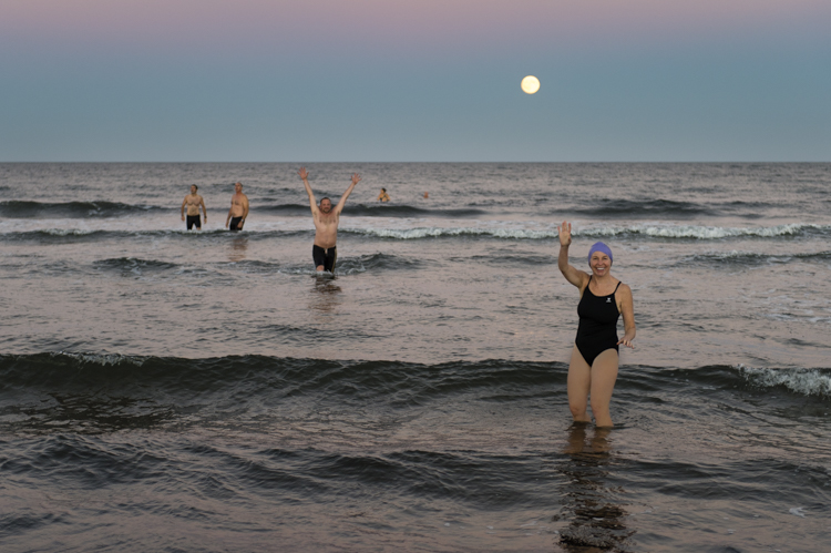 Mary Alice and the Newburyport Master Swimmers under the supermoon in September